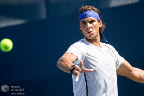 Rafa Nadal returns a ball during a practice session at the 2013 Western & Southern Open in Mason, OH
